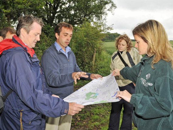 Group of ramblers with map in Heartwood Forest
